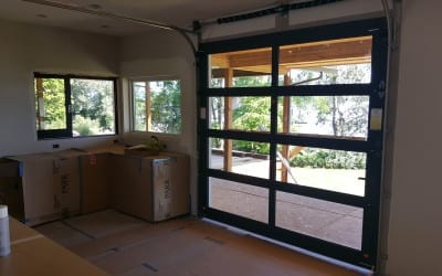 Super Cool Glass Garage Door in the Kitchen