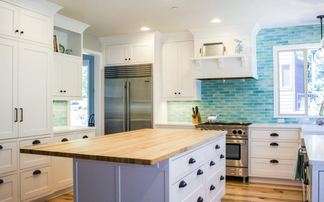 White Kitchen with Bold Blue Backsplash